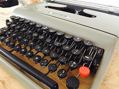 Vintage Retro Olivetti Lettera 22 Portable Typewriter With Case, shop display