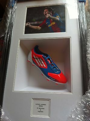 Leo Messi personally signed football boot and photograph