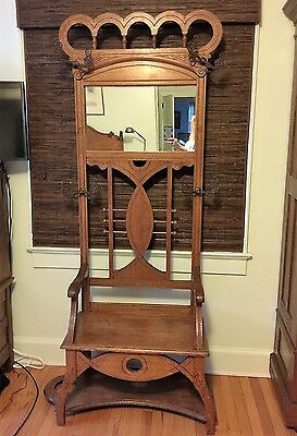 Antique golden oak hall tree bench with mirror