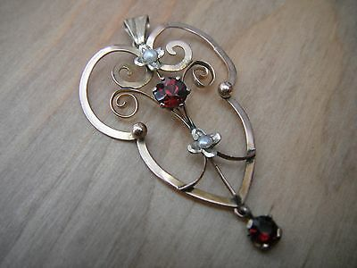 9 carat gold Edwardian pendant with garnet and seed pearl.