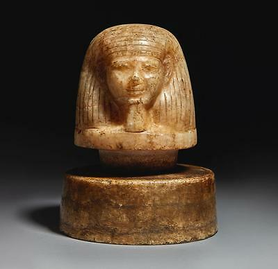 An Egyptian Alabaster Canopic Jar Lid, Early 18Th Dynasty, Circa 1540-1400 B....