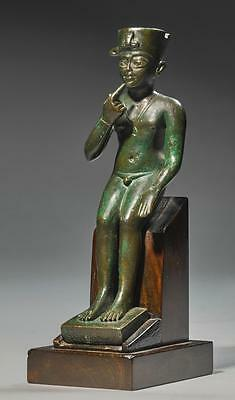 AN EGYPTIAN BRONZE FIGURE OF HARPOCRATES, LATE PERIOD, 716-30 B.C. | An Egypt...