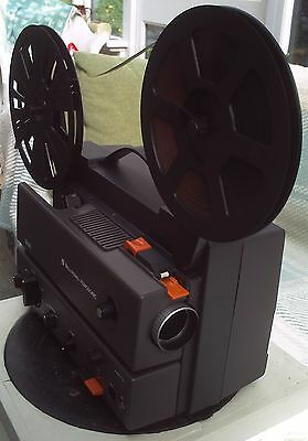 Bell and Howell Super 8mm Filmosonic DCR Projector. Includes four short Films