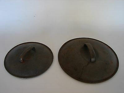 "TWO CAST IRON LID One 9"" and one 7-1/2"""