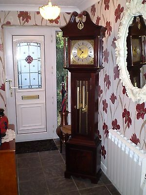 A lovely cottage style triple chime Grandfather clock in solid mahogany.