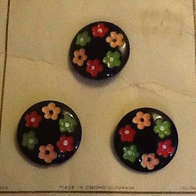 Vintage Black buttons with flowers around the edge.