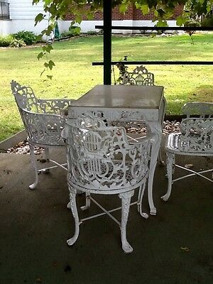 Cast Iron ornate table and chairs