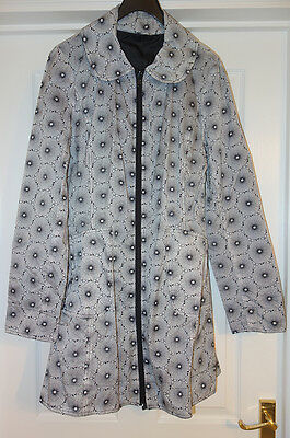 Reversible raincoat size M which folds up into a small bag
