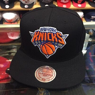 54b4962fba0 Mitchell   Ness NBA New York Knicks Snapback Hat Cap BLACK ORANGE CURRENT  Logo