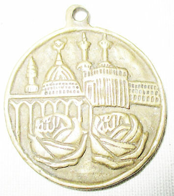 "antique brass pendent ""Medina Sherif"" and MACCA AND the reversa has the ALLAH,"