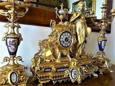 19Th Century French Gilt Metal Serves Style Mantel Clock Garniture.