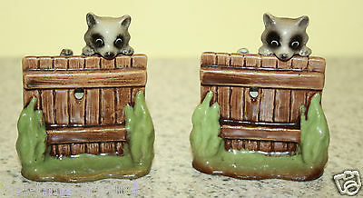 2 Retired Hagen Renaker Raccoon on Fence