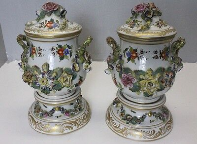 pair of porcelain hand painted Capodimonte style urn floral  vases