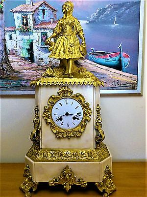 A French White Marble And Ormolu Figural Mantel Clock By Japy Freres.