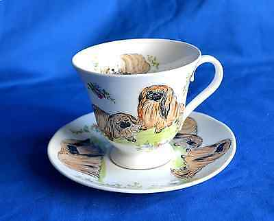 Hand painted china Cabinet Cup & Saucer with Pekingese - signed Sylvia Smith