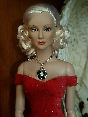 Beautiful tonner doll in red dress