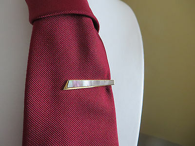 Vintage 1950s shell which shines grey purple and green tie clip