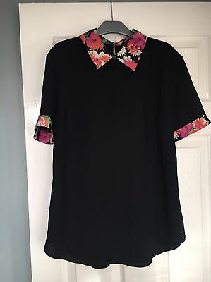 Womens size 10 black top from George with contrast floral collar/sleeve hem,used