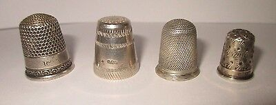 Four Thimbles including Hallmarked Silver and a Children's Thimble