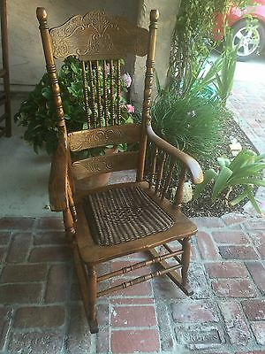 Vintage Adult Size Rocking Chair, Carved Wood, Wicker Seat, Spindle Back