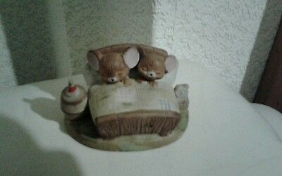 Two mice in a bed porcelain ornament