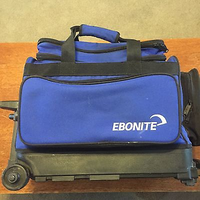 Ebonite Transport 2 Ball Roller Bowling Bag with Wheels Color is Blue With Black