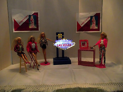 Barbie dolls going to Las Vegas sign lighted