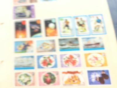 Turks & Caicos etc assortment of stamps from multiple collectors on pages