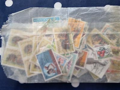 packet of stamps from Uganda mostly modern stamps ideal for packet maker