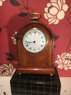 "BRAKE ARCH CLOCK IN A WALNUT CASE 10 1/4"" HIGH  in good working order."