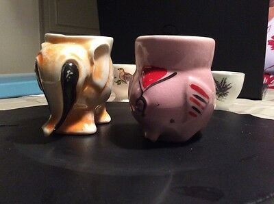 pair of vintage elephant egg cups