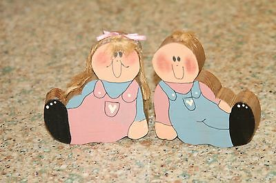 Cute Wood Country girl & boy Mauve, and country blue in color.