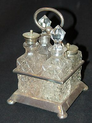 Nice Edwardian early 1900's 4 bottle silver plated cruet set in good condition
