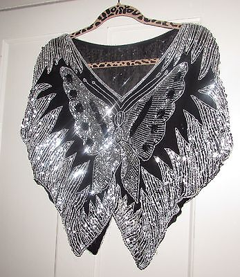 Butterfly sequin bat-wing party top