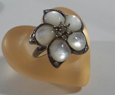 A Vintage Sterling Silver Mother of Pearl Cabochon Rhinestone Center Floral Ring