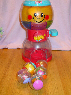 Fisher Price Swirlin' Lights & Sounds Roll A Rounds Gumball Machine  5 Balls