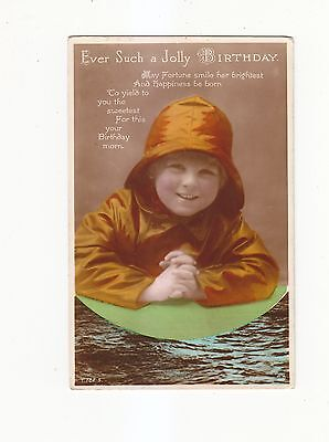 CHARMING POSTCARD OF A  SMILING CHILD IN A SOU'WESTER   ROTARY PHOTO  No T.122.5