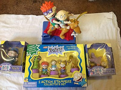 Lot of Rugrats toys, figures, bank stampers lot of 4