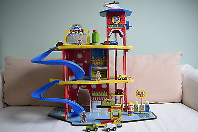 toy garage brightly coloured and made of wood, excellent condition