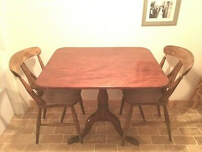 Wooden table and four wooden chairs