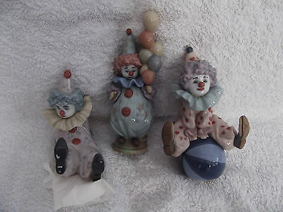 3 Lladro Clowns. 1) Having A Ball. 2) Tired Friend. 3) Littlest Clown.