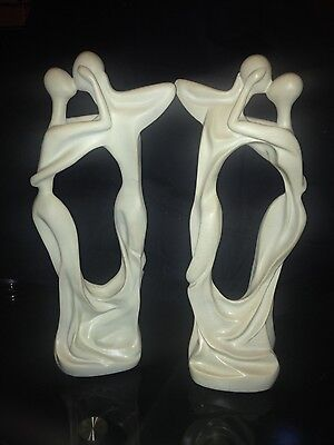 A Pair Of Abstract Sculptures Of A Couple Kissing Embracing