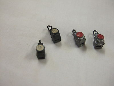 FOUR x Hornby pre war O gauge loco lamps. 2 x white. 2 x red with loops