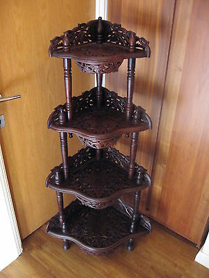 Ornate vintage hand carved wooden corner display stand inlaid with brass