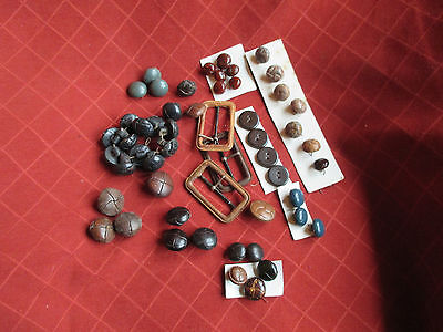 a quantity of old leather buttons and buckles