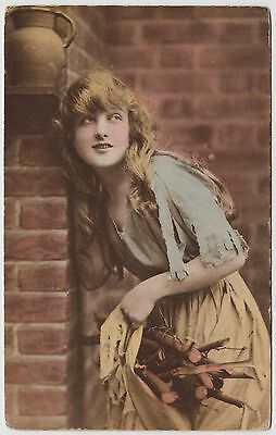 GLAMOUR POSTCARD - beautiful woman with long hair, torn clothes, gathering wood