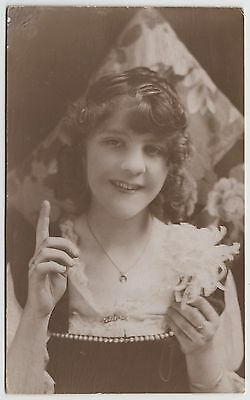 POSTCARD - pretty lady holds flower, actress? studio photo, Alfred Wager Bristol