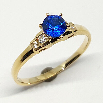 14K solid yellow gold wedding ring Sapphire & white Topaz stone size 7