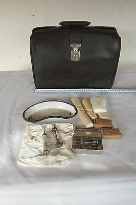 Old medical bag with authentic instruments and tools