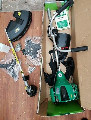 Petrol strimmer brush grass cutter with harness.